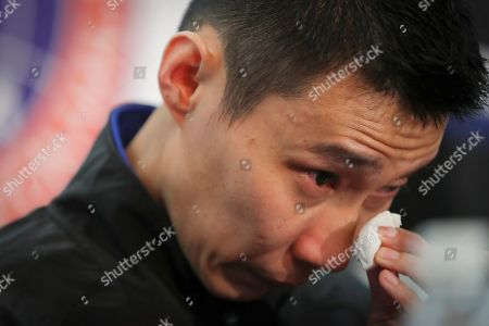 Malaysian badminton player Lee Chong Wei wipes his tears during a press conference in Putrajaya, Malaysia, . Former World No. 1-ranked Lee has announced his retirement from badminton after 19 years following his battle with cancer