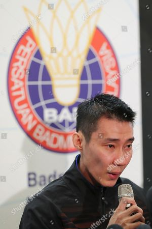 Malaysian badminton player Lee Chong Wei speaks during a press conference in Putrajaya, Malaysia, . Former World No. 1-ranked Lee has announced his retirement from badminton after 19 years following his battle with cancer