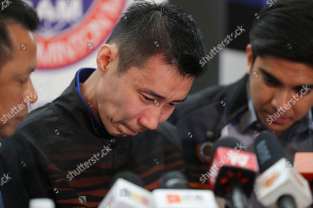 Malaysian badminton player Lee Chong Wei, center, cries during a press conference in Putrajaya, Malaysia, . Former World No. 1-ranked Lee has announced his retirement from badminton after 19 years following his battle with cancer