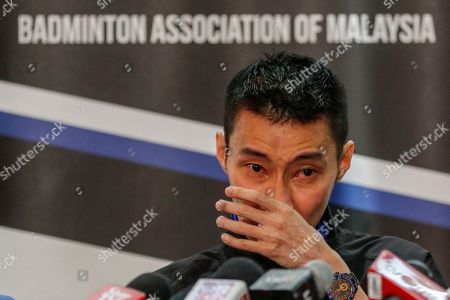 Malaysian badminton player Lee Chong Wei wipes away tears during a press conference in Putrajaya, Malaysia, 13 June 2019. Former world number one player Lee Chong Wei, 36, announced his retirement from the game due to being diagnosed with cancer.