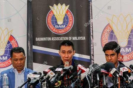Malaysian badminton player Lee Chong Wei (C), Badminton Association of Malaysia president, Norza Zakaria (L) and Malaysian Sports Minister, Syed Saddiq attend a press conference in Putrajaya, Malaysia, 13 June 2019. Former world number one player Lee Chong Wei, 36, announced his retirement from the game due to being diagnosed with cancer.