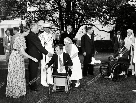 President Franklin Roosevelt and the First Lady received veterans from Walter Reed Hospital at a White House garden party. On Memorial Day weekend, they greeted legless World War I hero, Guy Pendleton and others. May 31, 1936