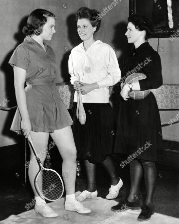 Stock Image of Student gym suits have changed over time. From a Barnard College exhibit: L-R: Deborah Allen wears a contemporary short skirted suit of 1939; Ingrid Bach wears bloomers from 1905; and Ruth Cummings wears a 1895 gym dress. Feb. 1939.