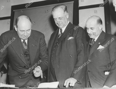 The SEC hearing into Amadeo Gianninis (center), Trans-America Corp. opened on Jan. 16, 1939. Before the Security and Exchange Commission, L-R: Attorney, Donald Richberg, former NRA head; Amadeo Giannini, Chrm. Of the Board; L. M. Giannini, Pres. Of the Bank of America.