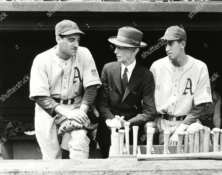 Philadelphia Athletics manager Connie Mack with Phil Marchildon (L) and Russell Christopher. Marchildon joined Royal Canadian Air Force as a tail gunner. He was POW at the infamous Stalag Luft III in Germany. He retuned to professional Baseball after WW2. May 1942.