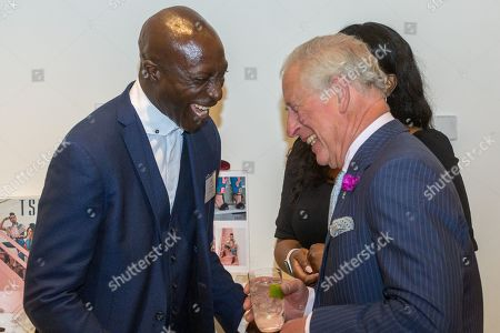 Stock Photo of Prince Charles shares a joke with Ozwald Boateng OBE