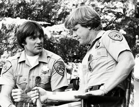 Bruce Jenner as Officer Steve McLeish and Larry Wilcox as Jon Baker on CHiPs. Jenner guest starred, substituting for star Erik Estrada, who was in a contract dispute with NBC and MGM. Scene is from Diamond in the Rough aired on Nov. 22, 1981.