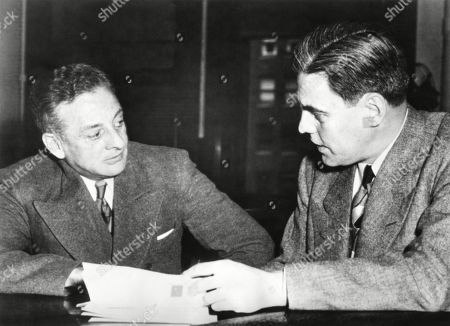 Roger Touley, confers with his attorney Robert Johnstone. May 23, 1949. Touley claims he was railroaded to prison by John Factor, the Capone mob, and the US government. Factor is the man Touly was charged with kidnapped in 1933.
