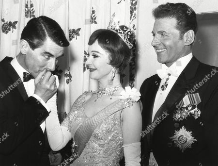 Director Peter Glenville kisses hand of Vivien Leighs hand with actor Jean Pierre Aumont at right. March 18, 1963. It was the opening night of the Broadway musical TOVARICH, which ran for 264 performances and won Leigh the Tony Award for Best Actress.