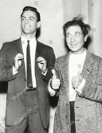 Stock Image of Harpo Marx gives a double thumbs up for his son, Bill. Jan 1961. Harpo and his wife actress Susan Fleming adopted four children: Bill, Alex, Jimmy, and Minnie. In 2008, Bill Marxs published his memoir, SON OF HARPO SPEAKS.