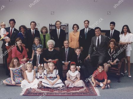 President George H. W. Bush and wife Barbara pose with their six children, their spouses and twelve grandchildren for a family portrait in Houston, Texas. Ca. 1991.