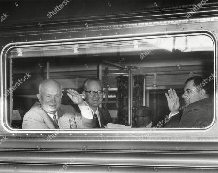 Premier Nikita Khrushchev waving from his train as he leaves Washington for New York City. Also waving at right is Andrei Gromyko, Foreign Minister of USSR. Sergei Khrushchev sits next to his father. Sept. 17, 1959. -