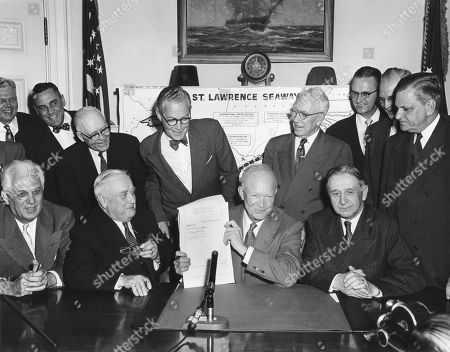 President Eisenhower at signs the Saint Lawrence Seaway Act of 1954. May 13, 1954. Seated L-R: Sen. Homer Ferguson; Sen. Alex Wiley; Pres. Eisenhower; Rep. George Dondero. -