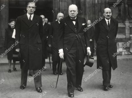 British leaders leaving the Westminster Abby memorial service for David Lloyd George. L-R: Foreign Secretary Anthony Eden, Prime Minister Winston Churchill, and Labour Party leader, Clement Atlee. April 10, 1945. -