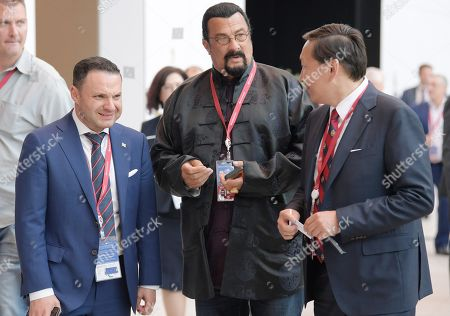American actor Steven Seagal (center) before the plenary session at the XXIII St. Petersburg International Economic Forum (SPIEF).