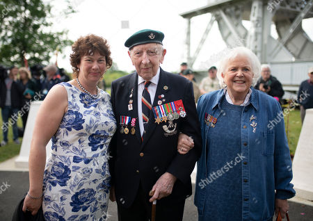 Stock Photo of Veteran Reg Charles 96, the last surviving member Ox and Bucks regiment to have served in the second World War with  Kerry Ricketts (Granddaughter of Major John Howard) and Penny Bates (daughter of Major John Howard) and at Pegasus Bridge during 6th Airborne Division Normandy Remembrance, part of the D-Day 75 celebrations.