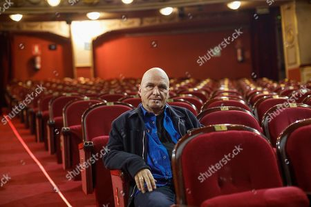 Stock Photo of Artistic director of theater company Fura dels Baus Carlus Padrissa poses during an interview at a theater in Madrid, Spain, 13 June 2019. Fura dels Baus returns to Madrid with their show 'Carmina Burana' by German Carl Orff that has already been enjoyed by 257 million people in 10 different countries.
