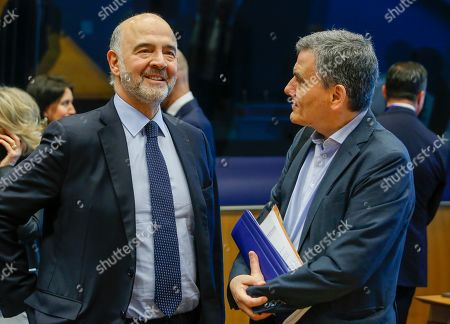 Pierre Moscovici, the European Commissioner for Economic and Financial Affairs and Taxation (L) and Greek Finance Minister Euclid Tsakalotos (R) at the start of the Eurogroup meeting in Luxembourg, 13 June 2019. The Eurogroup will discuss inequality in the eurozone, based on the European Commission analysis and also will have a presention of the outcome of the IMF's Article IV consultation with the euro area.