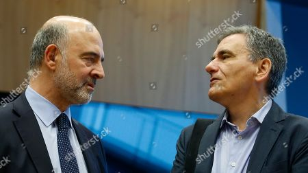 Pierre Moscovici, European Commissioner for Economic and Financial Affairs and Taxation,  and Greek Finance Minister Euclid Tsakalotos (R) at the start of the Eurogroup meeting in Luxembourg, 13 June 2019. The Eurogroup will discuss inequality in the eurozone, based on the European Commission's analysis and will present the outcome of the IMF's Article IV consultations with the euro area.