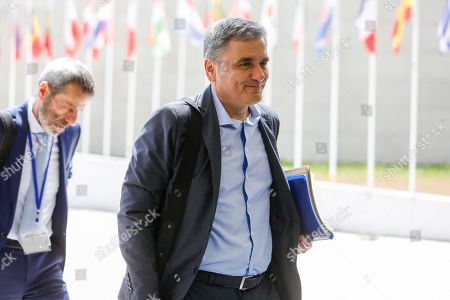 Greek Finance Minister Euclid Tsakalotos arrives for the Eurogroup meeting in Luxembourg, 13 June 2019. The Eurogroup will discuss inequality in the eurozone, based on the European Commission analysis and also will have a presention of the outcome of the IMF's Article IV consultation with the euro area.