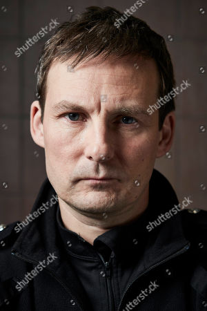 Stock Photo of Anthony Flanagan as PC Sean Cobley.