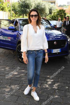 Anna Safroncik arrives at the headquarters of the Sardinia region.
