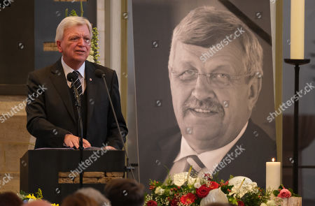 Volker Bouffier (L), Governor of the state of Hesse, delivers the eulogy while standing next to a portrait of murdered German politician Walter Luebcke at Luebcke's memorial service at St. Martin church in Kassel, Germany, 13 June 2019. Luebcke was found dead, shot in the head at close range, on the terrace of his home on 02 June. Investigators have ruled out suicide and are investigating the case as murder. Luebcke, a Christian Democrat (CDU), was outspoken in his pro-immigration views, and one possibility investigators are pursuing is a right-wing motive to the shooting.