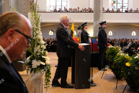 Volker Bouffier (2-L), Governor of the state of Hesse, delivers the eulogy while standing next to the coffin of murdered German politician Walter Luebcke at Luebcke's memorial service at St. Martin church in Kassel, Germany, 13 June 2019. Luebcke was found dead, shot in the head at close range, on the terrace of his home on 02 June. Investigators have ruled out suicide and are investigating the case as murder. Luebcke, a Christian Democrat (CDU), was outspoken in his pro-immigration views, and one possibility investigators are pursuing is a right-wing motive to the shooting.