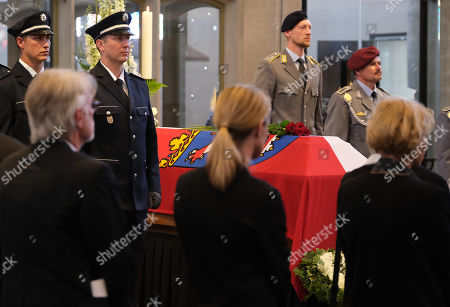 Stock Picture of Mourners pay their last respects at the coffin of murdered German politician Walter Luebcke at the conclusion of his memorial service at St. Martin church in Kassel, Germany, 13 June 2019. Luebcke was found dead, shot in the head at close range, on the terrace of his home on 02 June. Investigators have ruled out suicide and are investigating the case as murder. Luebcke, a Christian Democrat (CDU), was outspoken in his pro-immigration views, and one possibility investigators are pursuing is a right-wing motive to the shooting.