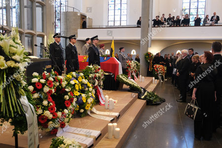 Mourners, including politician Roland Koch (R), pay their last respects at the coffin of murdered German politician Walter Luebcke at the conclusion of his memorial service at St. Martin church in Kassel, Germany, 13 June 2019. Luebcke was found dead, shot in the head at close range, on the terrace of his home on 02 June. Investigators have ruled out suicide and are investigating the case as murder. Luebcke, a Christian Democrat (CDU), was outspoken in his pro-immigration views, and one possibility investigators are pursuing is a right-wing motive to the shooting.