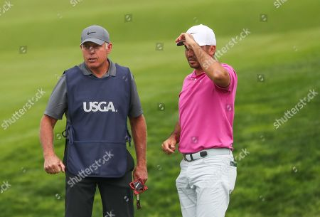 Jason Day from Australia on 9th green with his and Tiger Woods former caddie Steve Williams who has come out of retirement for tournament