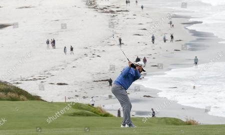 J. B. Holmes of the US hits on the ninth fairway during the first round of the 119th US Open Championship at the Pebble Beach Golf Links in Pebble Beach, California, USA, 13 June 2019. The tournament is played from 13 June to 16 June.