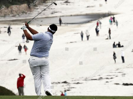 Kiradech Aphibarnrat of Thailand hits on the ninth hole during the first round of the 119th US Open Championship at the Pebble Beach Golf Links in Pebble Beach, California, USA, 13 June 2019. The tournament will be played from 13 June to 16 June.