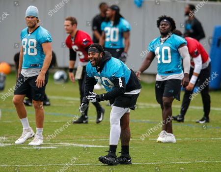 Carolina Panthers tackle Trai Turner (70) laughs during warm-ups at the NFL football team's mini-camp in Charlotte, N.C