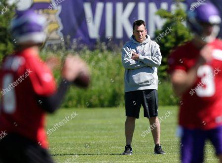 Minnesota Vikings assistant head coach and offensive advisor Gary Kubiak watches quarterbacks during drills at the team's NFL football training facility in Eagan, Minn
