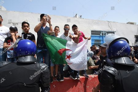 Protesters demonstrate as Algeria's former Prime Minister Abdelmalek Sellal is driven to custody at the El Harrach prison in Algiers, Algeria, 13 June 2019. Sellal was remanded in custody on 13 June after appearing before a judge as part of an anti-corruption investigation, state media reported. The decision against Sellal, an ally of ex-President Abdelaziz Bouteflika, comes a day after former premier Ahmed Ouyahia was also remanded in custody.