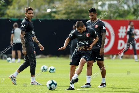 Peru's national soccer team players Paolo Guerrero (L), Aldo Corso (C) and Anderson Santamaria (R) participate in a training session in Porto Alegre, Brazil, 13 June 2019.