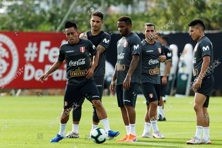 Peru's national soccer team players Christian Cueva (L), Paolo Guerrero (2-L), Jefferson Farfan (C) and Raul Ruidiaz (R) participate at a training session in Porto Alegre, Brazil, 13 June 2019.