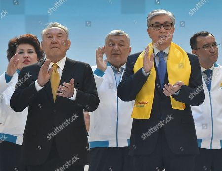 Presidential candidate of Kazakhstan, incumbent President of Kazakhstan Kassym-Jomart Tokayev (second right) and head of the Security Council of Kazakhstan, chairman of the ruling Nur Otan party, Nursultan Nazarbayev (second left) during a meeting with electorate