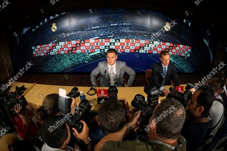 Real Madrid's new soccer player Eden Hazard (L) and Real Madrid's Institutional Relations Director Emilio Butragueno (R) attend a press conference during his presentation at Santiago Bernabeu stadium in Madrid, Spain, 12 June 2019. Belgian Eden Hazard has signed a five-seasons-contract with Real Madrid after Spanish LaLiga's club Real Madrid reached an agreement with Chelsea FC for his transfer for 100 million euro plus 30 on variables.