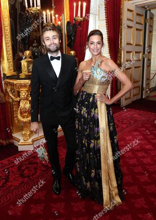 Stock Photo of Douglas Booth and Yasmin Le Bon