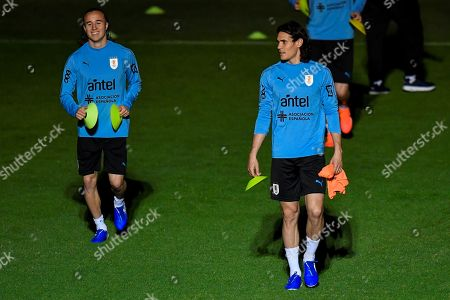 Uruguay's national soccer team players Diego Laxalt (L) and Edinson Cavani reacts during a training session ata SESC Venda Nova in Belo Horizonte, Brazil, 13 June 2019.