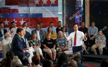 Democratic presidential candidate Julian Castro, right, answers a question during a FOX News Channel town hall event, in Tempe, Ariz. Fox News anchors Bret Baier, left, and Martha MacCallum, second from left, listen to Castro's answer