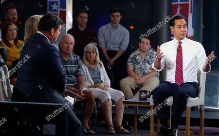 Democratic presidential candidate Julian Castro, right, speaks during a FOX News Channel town hall event, in Tempe, Ariz., as Special Report's Bret Baier, left, listens