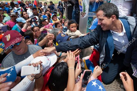 In this photo provided by the Juan Guaido press office, Venezuela's opposition leader and self-proclaimed interim President Juan Guaido greets supporters during a rally in Mucuchies, Merida state, Venezuela,. Guaidó has channeled the frustrations of angry Venezuelans suffering from food shortages made worse by punishing U.S. oil sanctions but has been unable to weaken President Nicolás Maduro's grip on power and sway over the all-power military