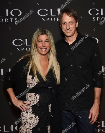 Nicole Purcell, Tony Hawk. Nicole Purcell President, Clio Awards, left, and Tony Hawk pose at The Clio Sports Awards at the Capitale Ballroom, in New York