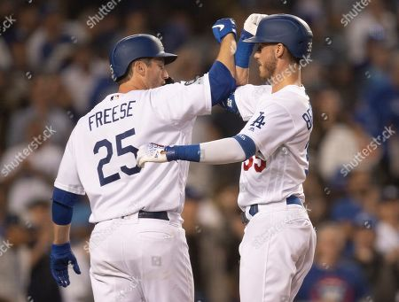 Los Angeles Dodgers' Cody Bellinger, right, celebrates his two-run home run with David Freese during the fourth inning of a baseball game against the Chicago Cubs in Los Angeles