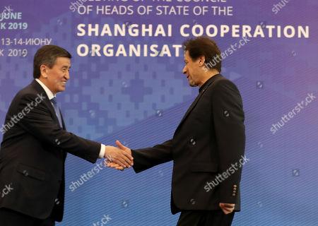 Pakistani President Mamnoon Hussain (R) shakes hands with Kyrgyzstan's President Sooronbay Jeenbekov (L) during the 19th Shanghai Cooperation Organization (SCO) Summit in Bishkek, Kyrgyzstan, 14 June 2019.