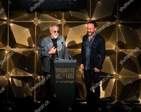 Dave Matthews ; Yusuf Islam. Yusuf Islam, left, and Dave Matthews speak on stage at the 50th annual Songwriters Hall of Fame induction and awards ceremony, in New York