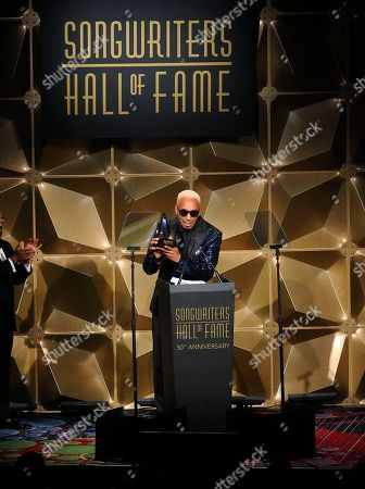 Dallas Austin speaks on stage at the 50th annual Songwriters Hall of Fame induction and awards ceremony at the New York Marriott Marquis Hotel, in New York